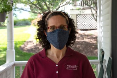 Virginia Tech Autism Center Director Angela Scarpa poses at her home, wearing a mask because of the coronavirus pandemic